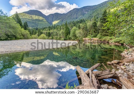 Peaceful reflection in Golden ears provincial Park, British Columbia, Canada. - stock photo