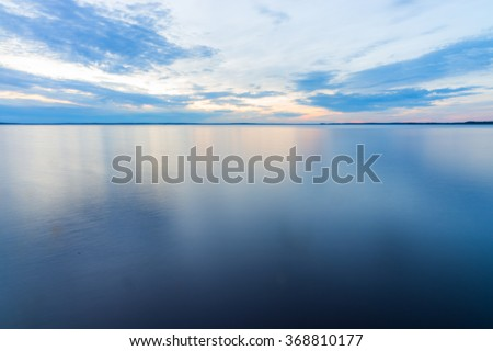 Peaceful Tranquil Water Landscape Shot at Long Exposure with Calm Flat Surface - stock photo