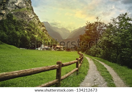 Peaceful view of countryside in Swiss Alps - stock photo
