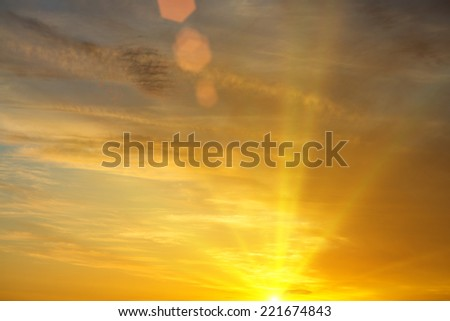 Peaceful warm image of yellow sunset and sunbeams - stock photo