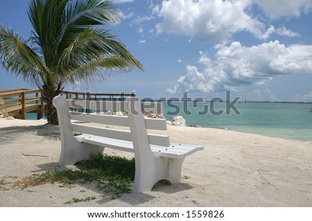 Peaceful white park bench overlooking the ocean in the Florida Keys - stock photo