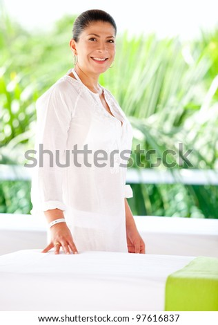 Peaceful woman at an outdoors spa smiling - stock photo