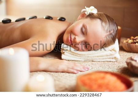 Peaceful woman enjoying spa procedure - stock photo