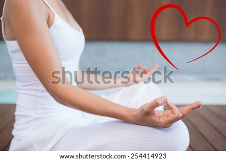Peaceful woman in white sitting in lotus pose against heart - stock photo