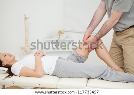 Peaceful woman lying while being manipulated in a medical room - stock photo