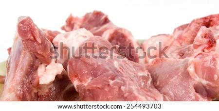 Peaces of fresh uncooked pork isolated on white background - stock photo