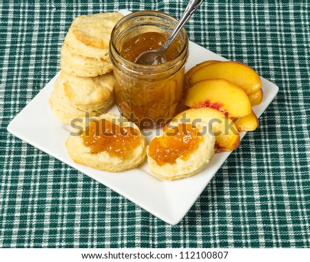 Peach jam or jelly with biscuits and peaches - stock photo