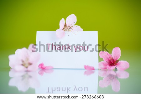Peach pink flowers on a green background - stock photo