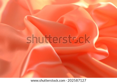 Peach silk background fabric for decoration and ornaments. - stock photo