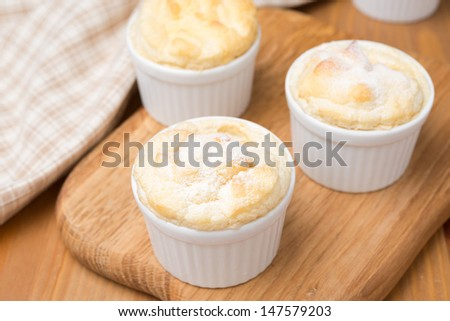 peach souffle in the portioned form on a wooden board, top view, horizontal - stock photo