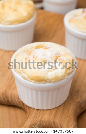 peach souffle in the portioned form, vertical close-up - stock photo