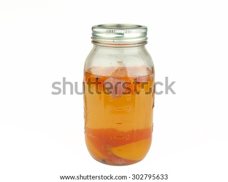 peach, strawberry fruit flavored moonshine alcohol in a mason jar - stock photo