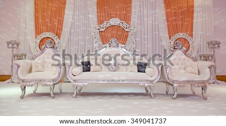 Peach themed wedding stage lit up - stock photo