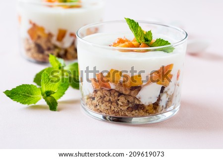 Peach trifle with crunchy toasted oats and dried fruit - stock photo
