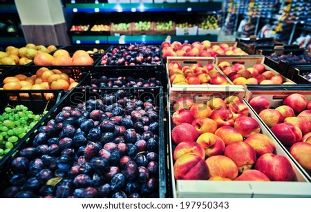 peaches and plums at the grocery store - stock photo