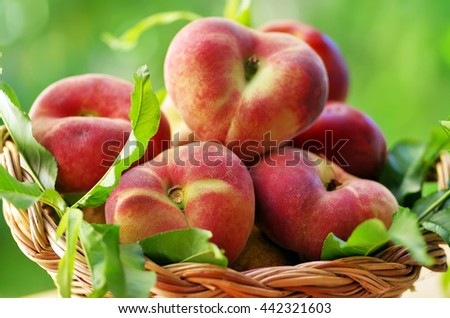 peaches in wooden basket - stock photo