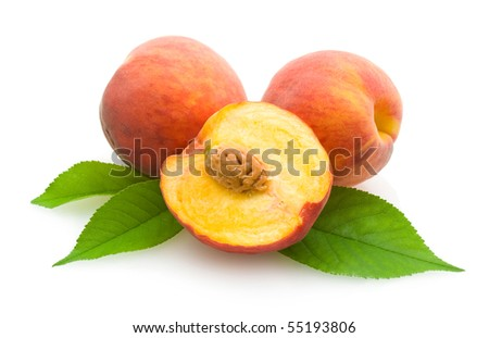 peaches with leaves - stock photo