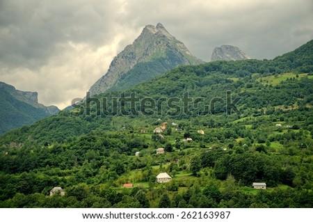 peak of Moraca mountain above montenegrin rural area - stock photo