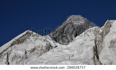 Peak of Mt Everest and glacier - stock photo