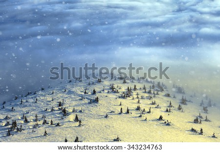 Peaks above clouds, winter mountains, foggy morning - stock photo