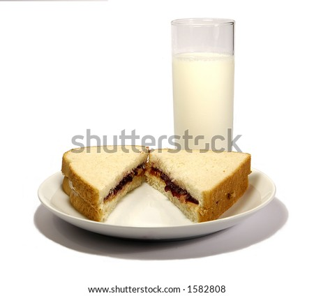 peanut butter and jelly sandwich and glass of milk - stock photo