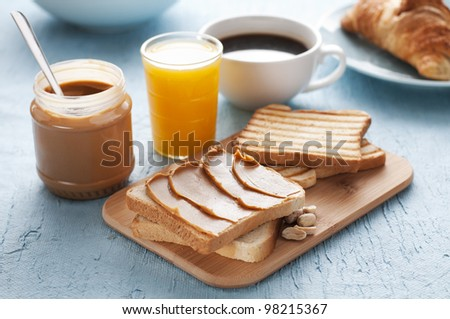 Peanut butter and toast for breakfast close up - stock photo