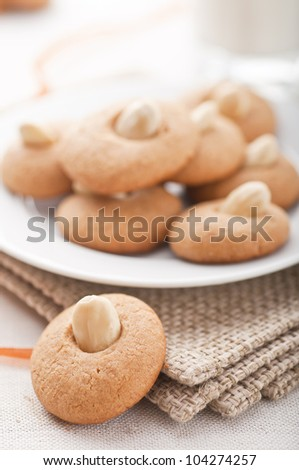 Peanut butter cookies with a cup of milk - stock photo