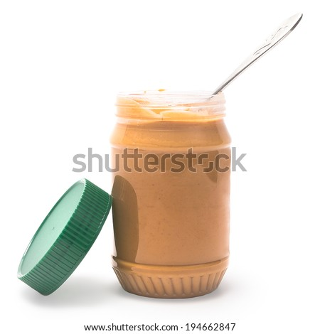 Peanut Butter in a Jar Ready to Serve with Spoon Isolated on a White Background - stock photo