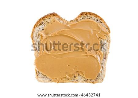 Peanut butter on a slice of homemade multigrain bread. - stock photo