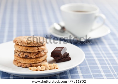 Peanut cookies with chocolate and cup of coffee or tea. - stock photo