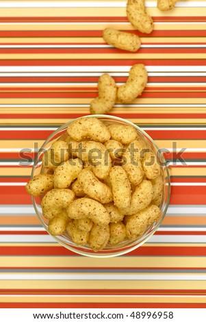peanut flips on stripe background - stock photo