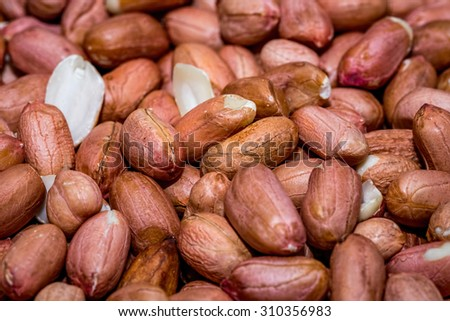 Peanut kernels - Macro view of some dehusked or shelled peanuts. - stock photo