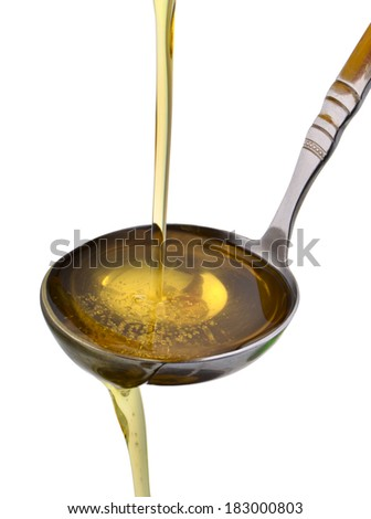 peanut oil poured into a spoon isolated on white background - stock photo
