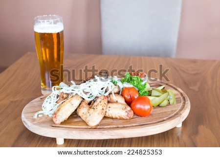 Peanuts and a Beer, against the background of the bar interior - stock photo