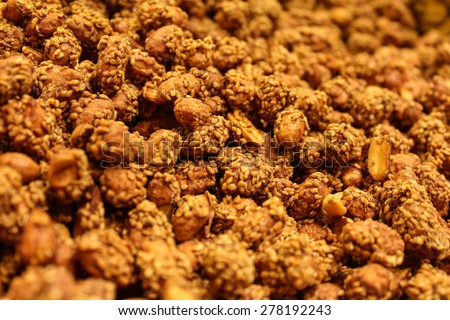 Peanuts breaded in sesame seeds. - stock photo
