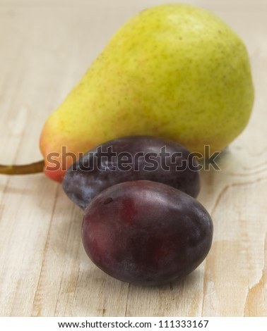 pear and plums - stock photo