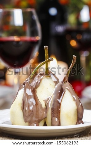 Pear in chocolate - stock photo