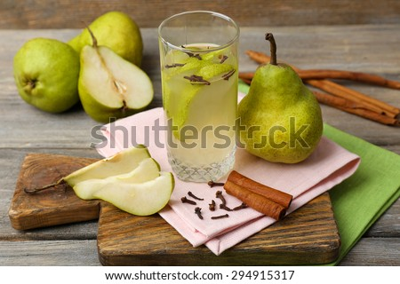 Pear juice with fresh fruits on table close up - stock photo