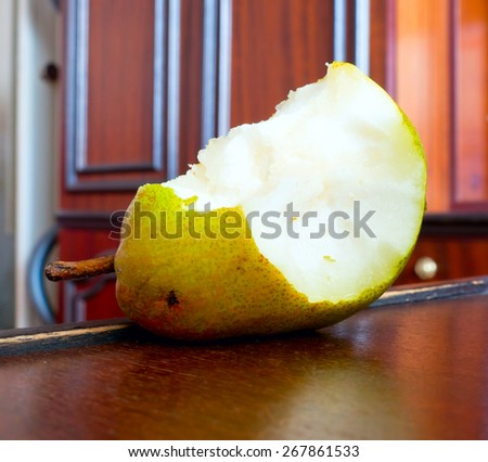 Pear nibble. - stock photo