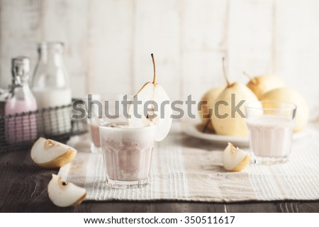Pear smoothie with strawberry cedar milk in glass - stock photo