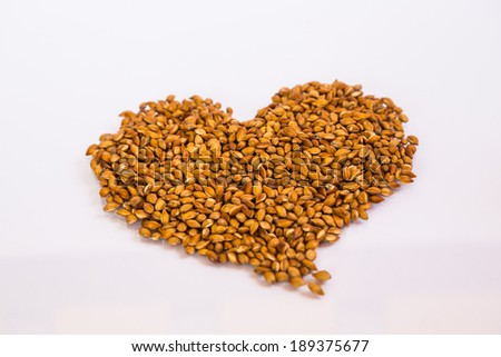 Pearl barley heap heart isolated on white  - stock photo