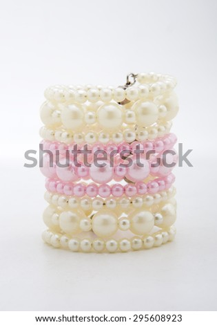 Pearl bracelet isolated on a white background. - stock photo