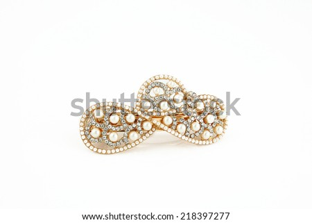 Pearl brooch isolated on a white background - stock photo
