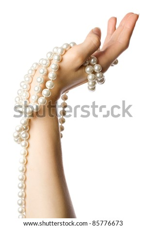 Pearl in the woman hand - stock photo