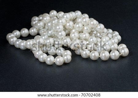 Pearl isolated on black - stock photo