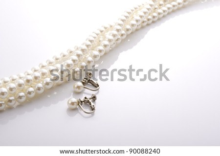 pearl necklace and earrings - stock photo