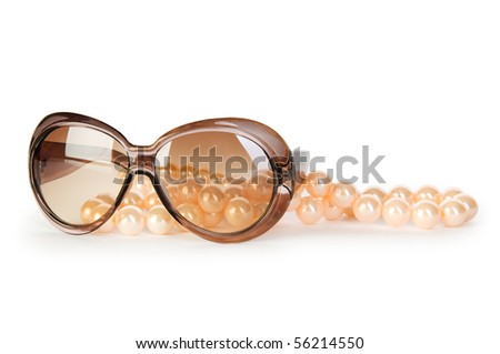 Pearl necklace and sunglasses isolated on the white background - stock photo