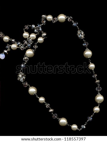 pearl necklace on a black background - stock photo