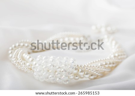 Pearl necklace on white background - stock photo