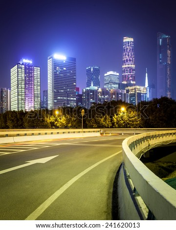 pearl river new town at night,modern buildings and green lawn in guangzhou central business district  - stock photo